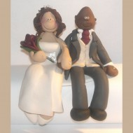 A Great Example Of One Our Sitting Down Cake Toppers