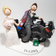 A Groom On His BMW Motorbike With Bride Holding