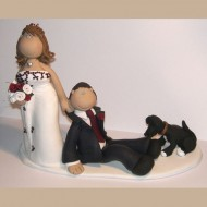 bride-dragging-groom-cake-topper