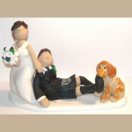 bride-dragging-groom-dog-biting-cake-topper