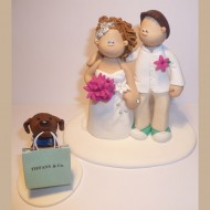 bride-groom-dog-carrying-bag-cake-topper