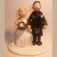 bride-groom-hand-on-bum-cake-topper