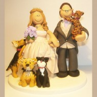 bride-groom-holding-cat-cake-topper