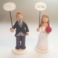 bride-groom-holding-signs