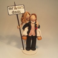 bride-groom-piggy-back-cake-topper
