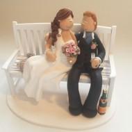 bride-groom-on-bench-cake-topper