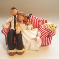 bride-groom-sitting-on-sofa-cake-topper