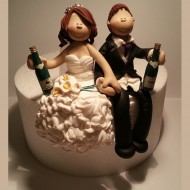 bride-groom-sitting-with-champagne-cake-topper