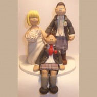 bride-groom-with-son-in-kilt-cake-topper