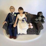 couple-on-sofa-wedding-cake-topper