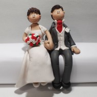 couple-sitting-cake-topper