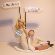cricket-dragging-cake-topper