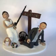 groom hooked by fishing rod cake topper