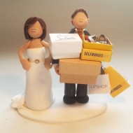 groom-carrying-boxes-cake-topper