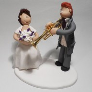 groom-playing-trumpet-cake-topper