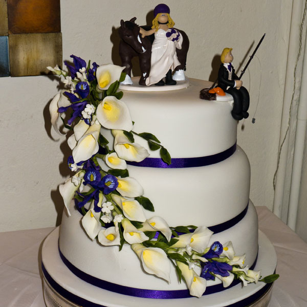 A Groom Fishing Off The Side Of His Wedding Cake