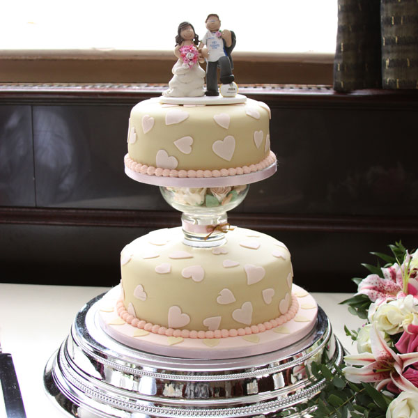 A Leeds United Wedding Cake Topper On Top Of The