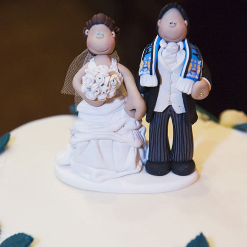 A Close Up Of The Man City Wedding Cake Topper