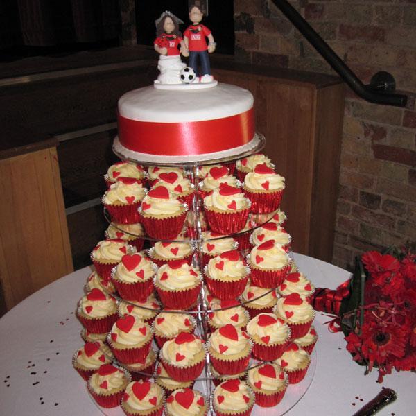 A Stunning Cupcake Wedding Cake With Man Utd Topper