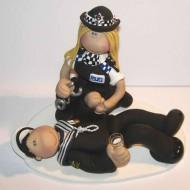 policewoman-arresting-cake-topper