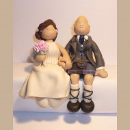 scottish-groom-sitting-cake-topper