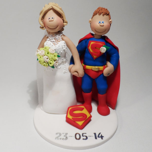 A Bride With Her Superhero Groom In His Superman Outfit